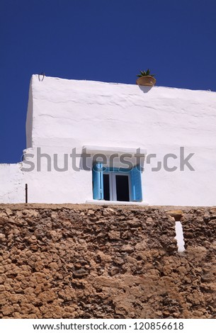 Morocco, El Jadida, Azemmour, pretty whitewashed house facade detail  behind the ancient fortified Medina wall. - stock photo