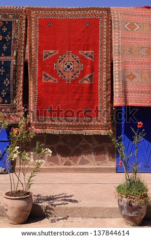 Morocco, Marrakesh, Colourful Berber carpets for sale hanging on display - stock photo