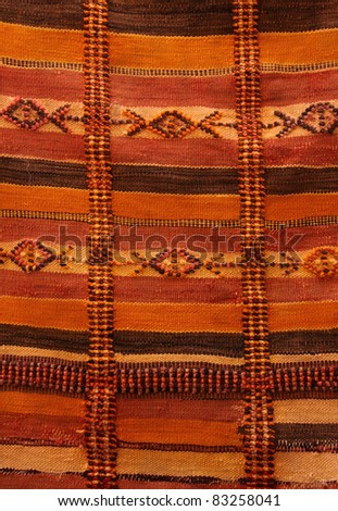 Morocco Marrakesh medina - detail ot typical Berber carpet on display - stock photo