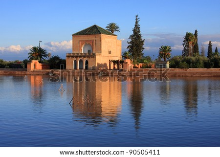 Morocco Marrakesh Menara Pavillion reflected on lake in late afternoon sunshine