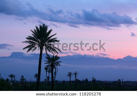 Morocco, Marrakesh, Panorama at dusk of the Atlas Mountains with light snow cover on the peaks. - stock photo