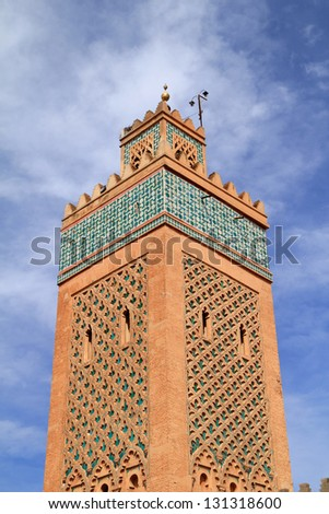 Morocco, Marrakesh, The Kasbah Mosque or El Mansour Mosque minaret against a dramatic blue sky and clouds
