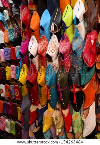 Morocco, Marrakesh, Typical colorful 'babuchas' - hand crafted leather slippers on display in the Medina souk. UNESCO World Heritage site. - stock photo