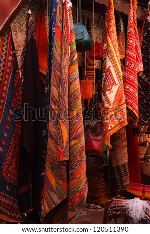 Morocco, Marrakesh, Typical colourful woollen rugs and handy-craft articles on display in the historical Medina souk.  - stock photo