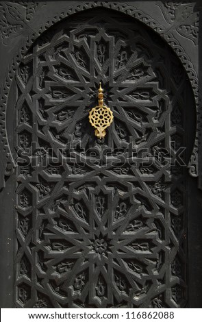 Morocco Marrakesh typical old arabesque door with brass door-knock. - stock photo