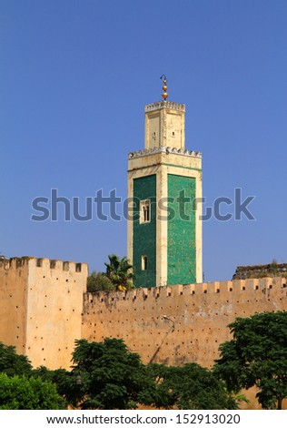 Morocco, Meknes, Historical city wall and  mosque minaret in Arabesque design - clad with green ceramic tiles - UNESCO World Heritage