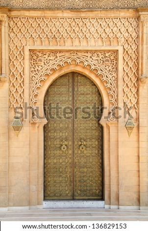 Morocco, Rabat, typical old arabesque intricate engraved brass door and surround in sandstone  sculpted in detailed Islamic design