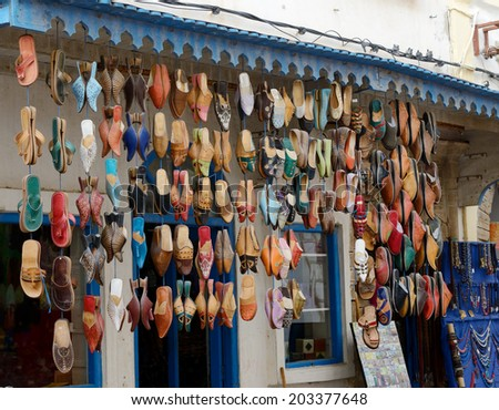 Morocco shop front selling colorful leather footwear - stock photo