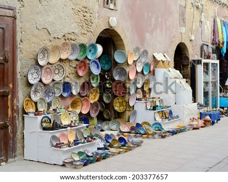 Morocco shop front showing handmade crafts and pottery