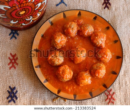 Morocco Tajine of Kafta - Typical Moroccan and Lebanese dish of meatballs in a tomato sauce with paprika cumin and garlic - cooked in a clay 'tajine' dish. - stock photo