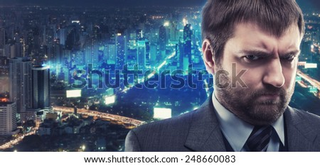 Morose businessman against city