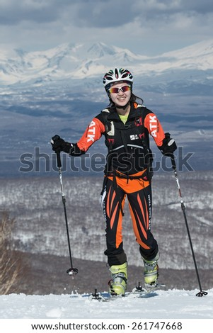 MOROZNAYA MOUNT, KAMCHATKA, RUSSIA - APRIL 25, 2014: Ski mountaineer Ma Nan (China) climb on skis on mountain. Vertical race ski mountaineering Asian, ISMF, Russian, Kamchatka Championship. - stock photo