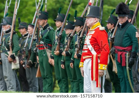 MORRISBURG, CANADA - JULY 14: Men standing at attention during the Battle of Crysler's Farm reenactment on July 14, 2013 near Morrisburg, Ontario.