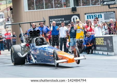 Morrison, CO - June 16, 2013: Car 57 Christine Chambless Alcholol Dragster pops a wheelie at the start line during Thunder on the Mountain presented by Grease Monkey at Bandimere Speedway. - stock photo