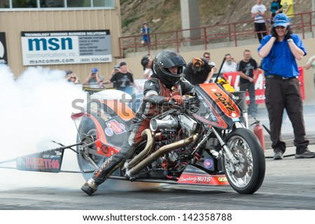 Morrison, CO - June 15, 2013: Dorn Racing Team  bike burns out during Thunder on the Mountain presented by Grease Monkey at Bandimere Speedway. - stock photo