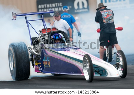 MORRISON, CO - JUNE 15: Top Dragster Deb Renck in Car 5158 does a burnout during Thunder on the Mountain presented by Grease Monkey at Bandimere Speedway on June, 15, 2013 in Morrison, Co.  - stock photo