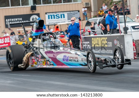 MORRISON, CO - JUNE 15: Top Dragster Phil Unruh in Car 51 does a wheelie off the starting line during Thunder on the Mountain presented by Grease Monkey at Bandimere Speedway on June, 15, 2013 in Morrison, Co.  - stock photo
