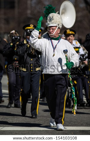 MORRISTOWN, NJ - MARCH 9: The leader of a brass-band formation dressed in traditional Irish uniform parade at the Saint Patrick's Day festival on March 9, 2013 in Morristown, NJ, USA.