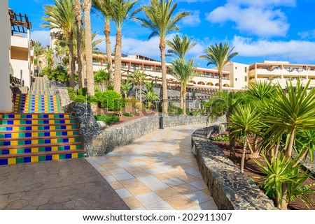 MORRO JABLE, FUERTEVENTURA - FEB 6, 2014: walking alley in tropical gardens of luxury hotel Barcelo Jandia Mar. This is a popular holiday destination for tourists on Fuerteventura island.