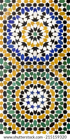 Morrocan traditional mosaic ornament from the Ben Youssef Madrasa in Marrakesh. - stock photo