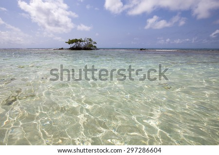 Morrocoy National park, paradise islands with coconut trees, white sand beaches, turquoise ocean and deep blue sky in Venezuela - stock photo