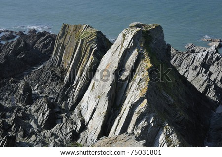 Mort Slate rock formation at Bull Point - stock photo