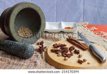Mortar and chopping block on orange table,asia cuisine