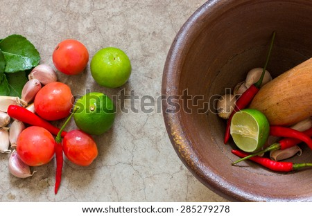 mortar and pestle, thai cooking tool - stock photo