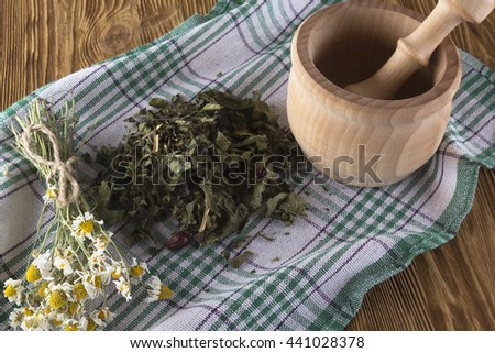mortar and pestle with herbal tea. - stock photo
