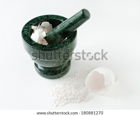 Mortar & Pestle with Egg Shells - stock photo