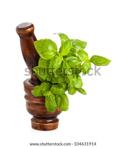 Mortar with basil isolated on white - stock photo