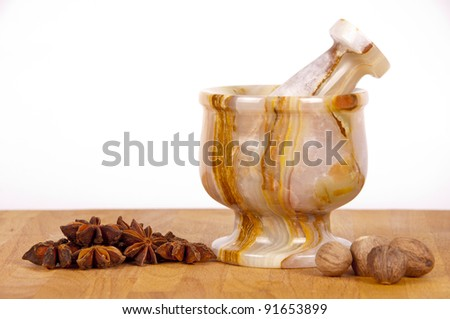 mortar with different spices - stock photo