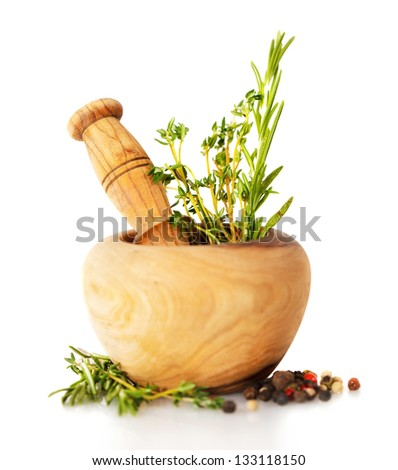 Mortar with fresh herbs isolated on white background - stock photo