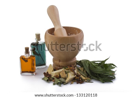 Mortar with herbs and oils - stock photo