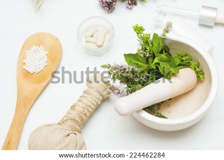 mortar with spices on white wooden table - stock photo