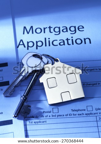 Mortgage Application and house keys - stock photo