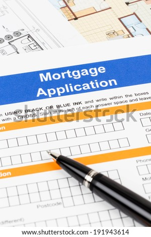 Mortgage application with pen - stock photo