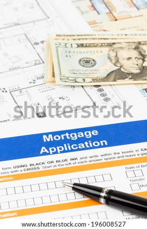 Mortgage application with pen, banknote, and drawing