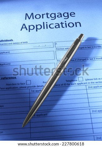 Mortgage Application with silver pen - stock photo