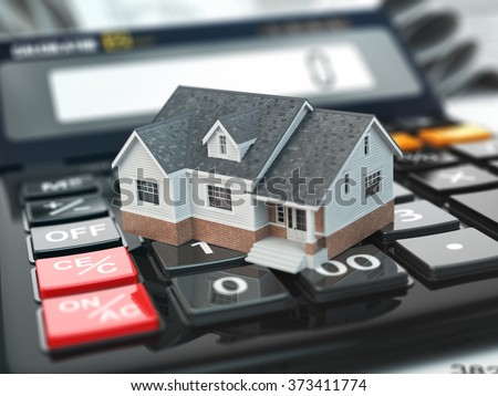 Mortgage calculator. House on buttons. Real estate concept. 3d - stock photo