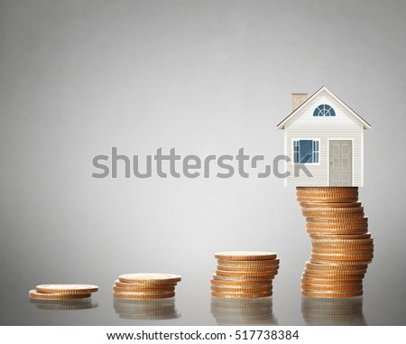 mortgage concept by money house from a coins