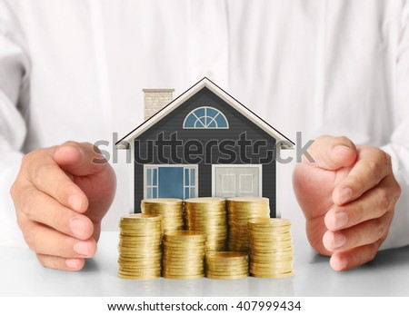Mortgage concept by money house from the coins - stock photo