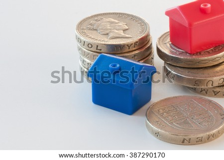 Mortgage concept rising house prices - stock photo