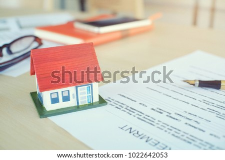 Mortgage contract for sale of contract house with paper and vintage tone.