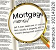 Mortgage Definition Magnifier Shows Property Or Real Estate Loan - stock photo
