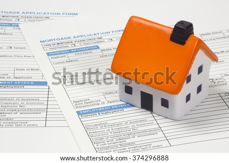 Mortgage documents with stress ball house