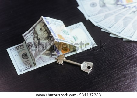 Mortgage, investment, real estate and property concept. Dollar money and house keys