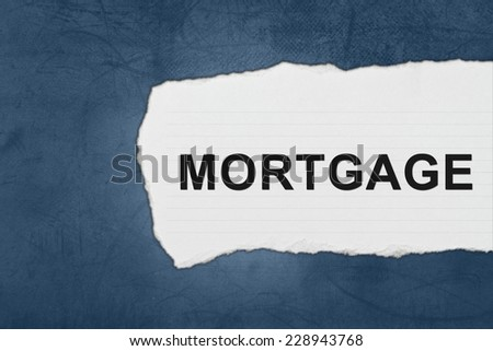 mortgage with white paper tears on blue texture - stock photo