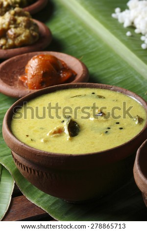 Moru curry or butter milk curry with coconut milk from kerala, India. And this is served with rice.