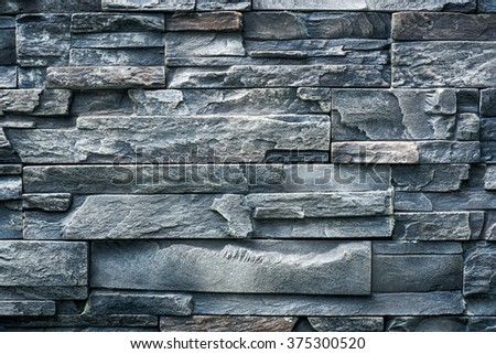 Mosaic brick wall pattern wallpaper background with retro colour style - stock photo